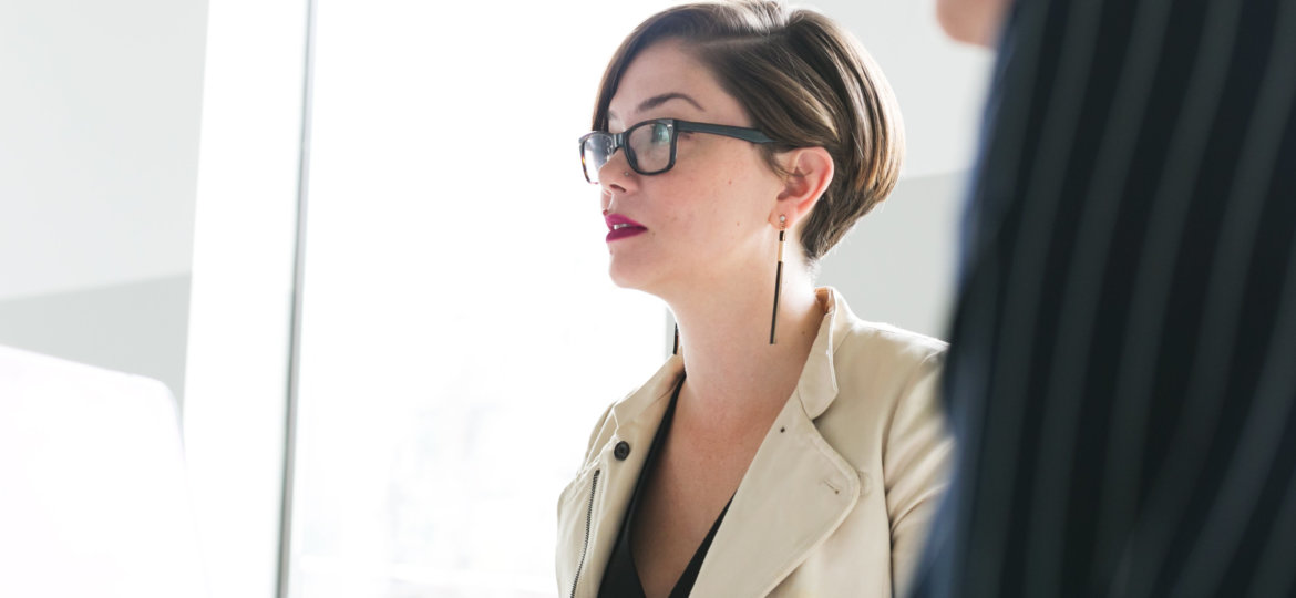 woman-in-glasses-at-meeting